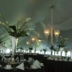 Chandelier lighting set under a pole tent for a huge party
