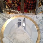 White china with gold lining and silverware