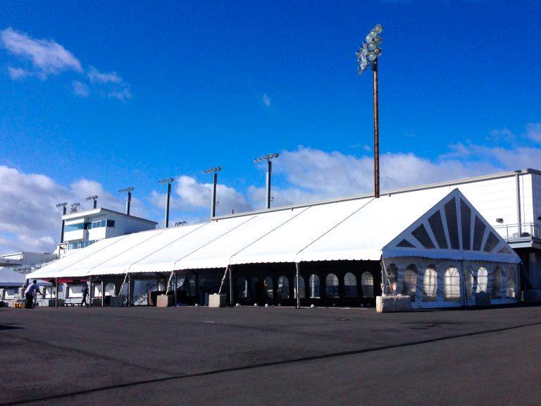 White frame tent set on parking lot