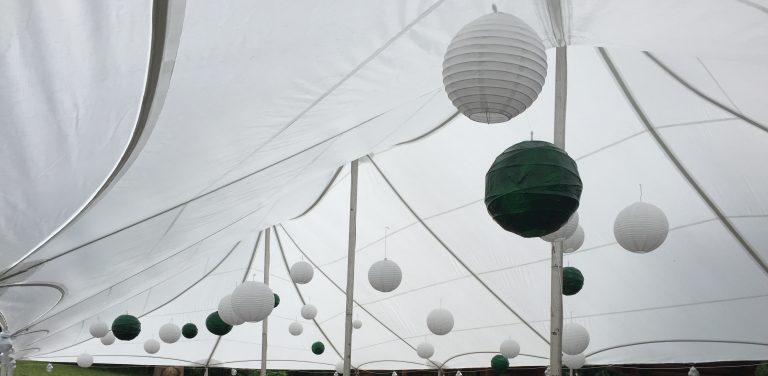 Tent ceiling lighting and decor setup