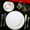 Placesetting with white plates and silverware
